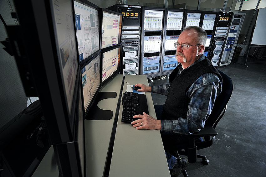 Man at electric utility headquarters with CBRS LTE Network